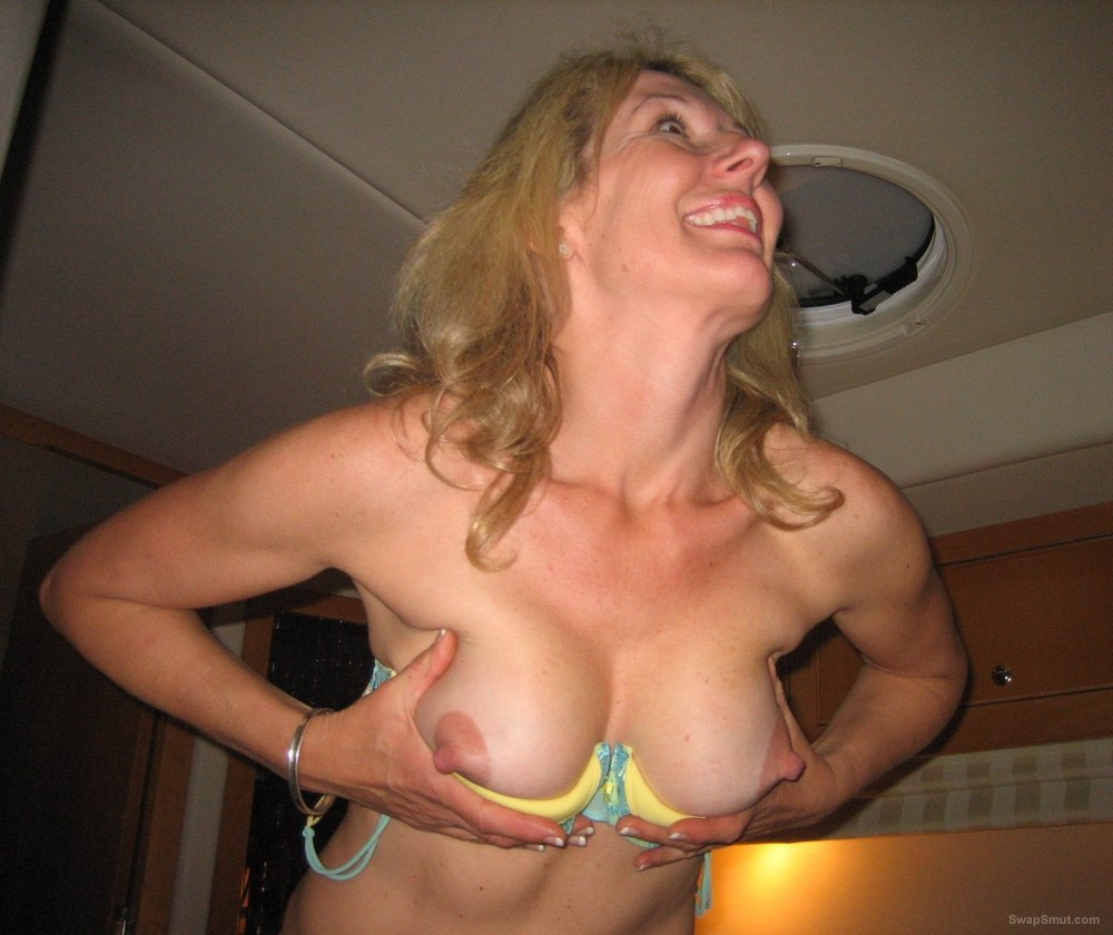 Stunning blonde milf having some adult fun cupping breasts