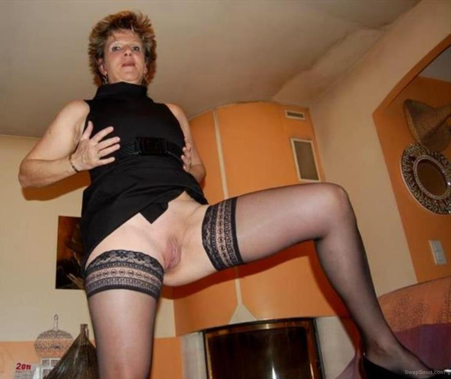 A mature friend posing and having fun around the house