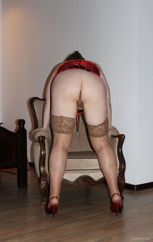 Woman in red waiting for sex and shows us her naked body