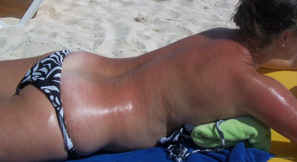 My 50 year old wife loves to show off sunbathing outdoors in a bikini