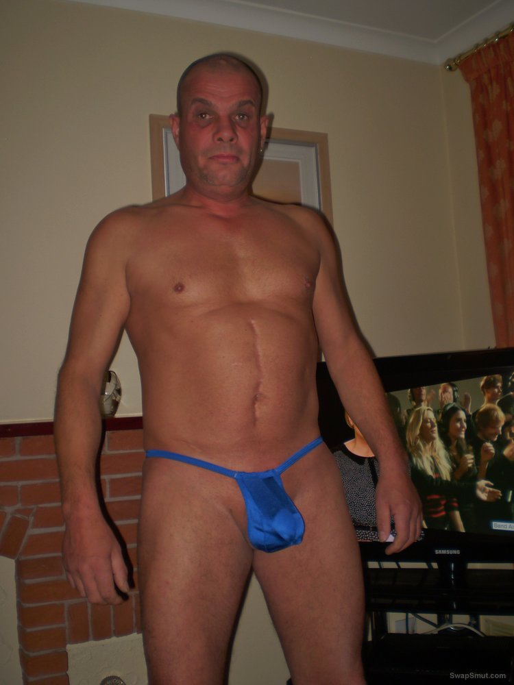 Me in thong with cock ring getting sucked off by two men