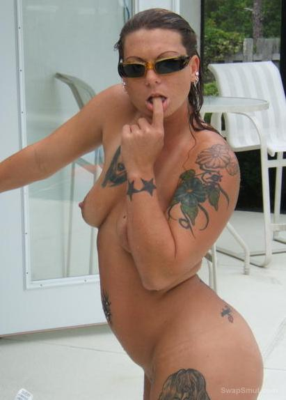 Angel tattooed amateur with sexy feet showing off by the pool