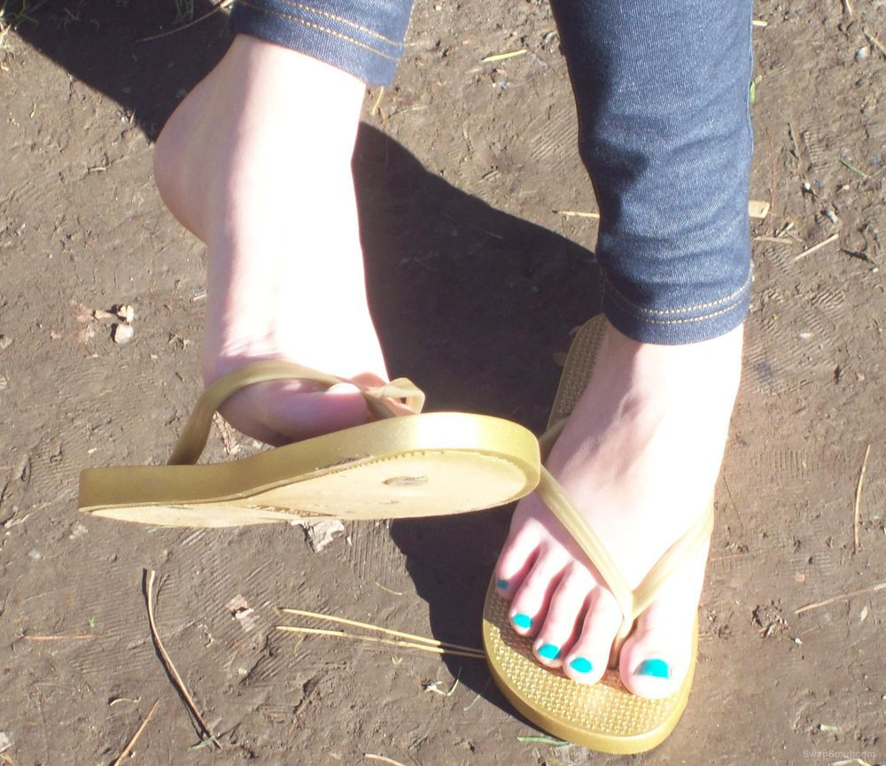 More pics of my sexy feet giving a hand foot job and painted toenails