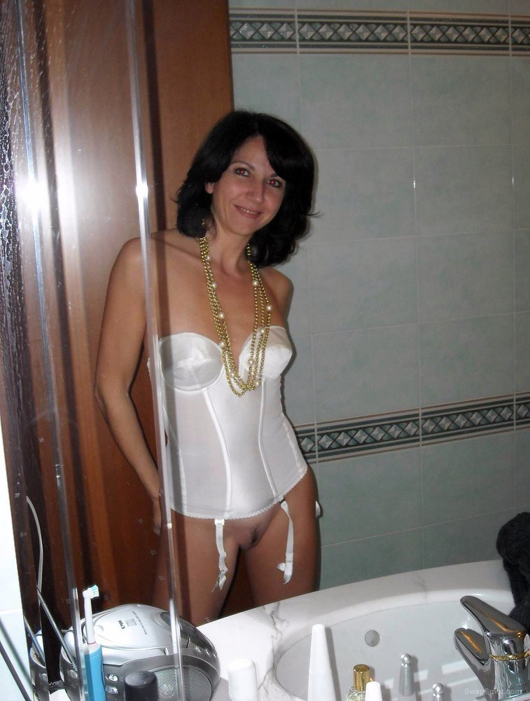 Milf wife posing for pictures wearing lingerie