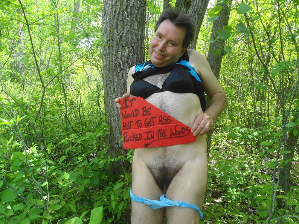 Posing in the woods wearing panties and a bra