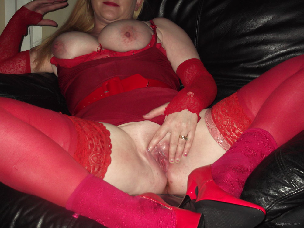 Sexy blonde busty wife dressed up in a sexy red lingerie outfit