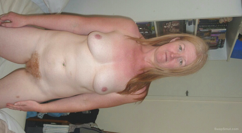 Mature redhead with an amazing body