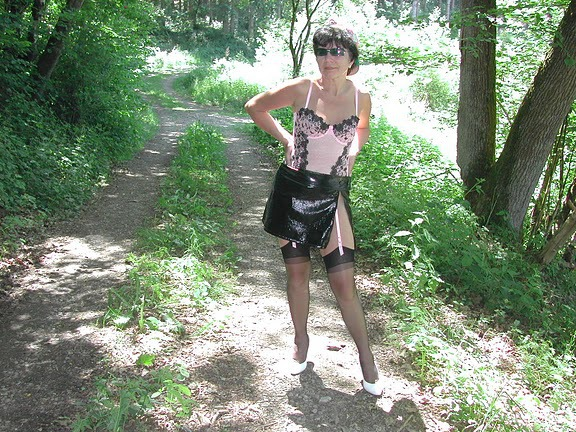 Mature Outdoors wearing sexy revealing clothes