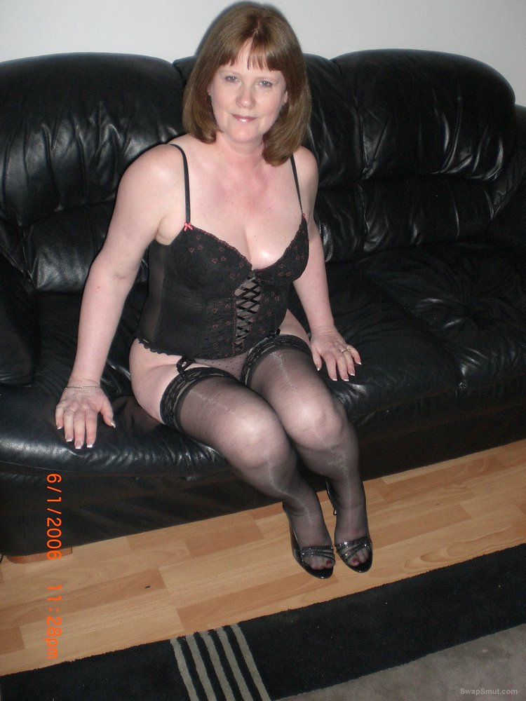 Stunning UK mom LORNA posing on a couch in sexy black lingerie