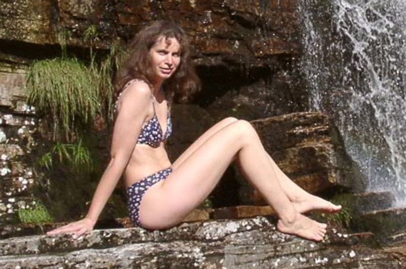 Nude german girl Bettina posing outdoor by a waterfall