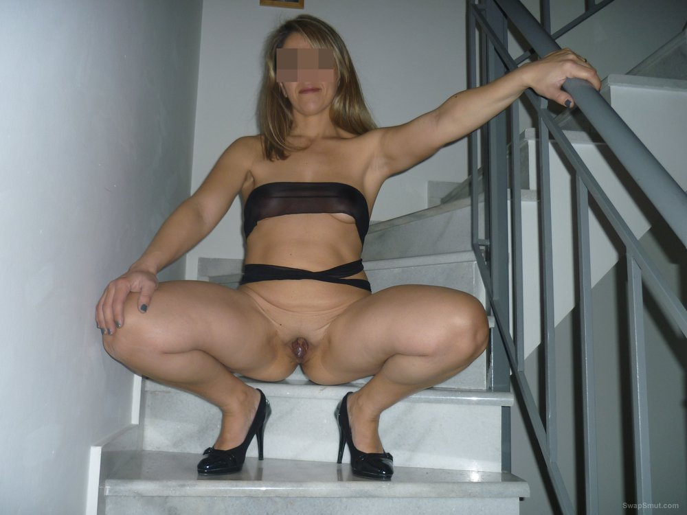 A very sexy wife showing off her hot tanned body
