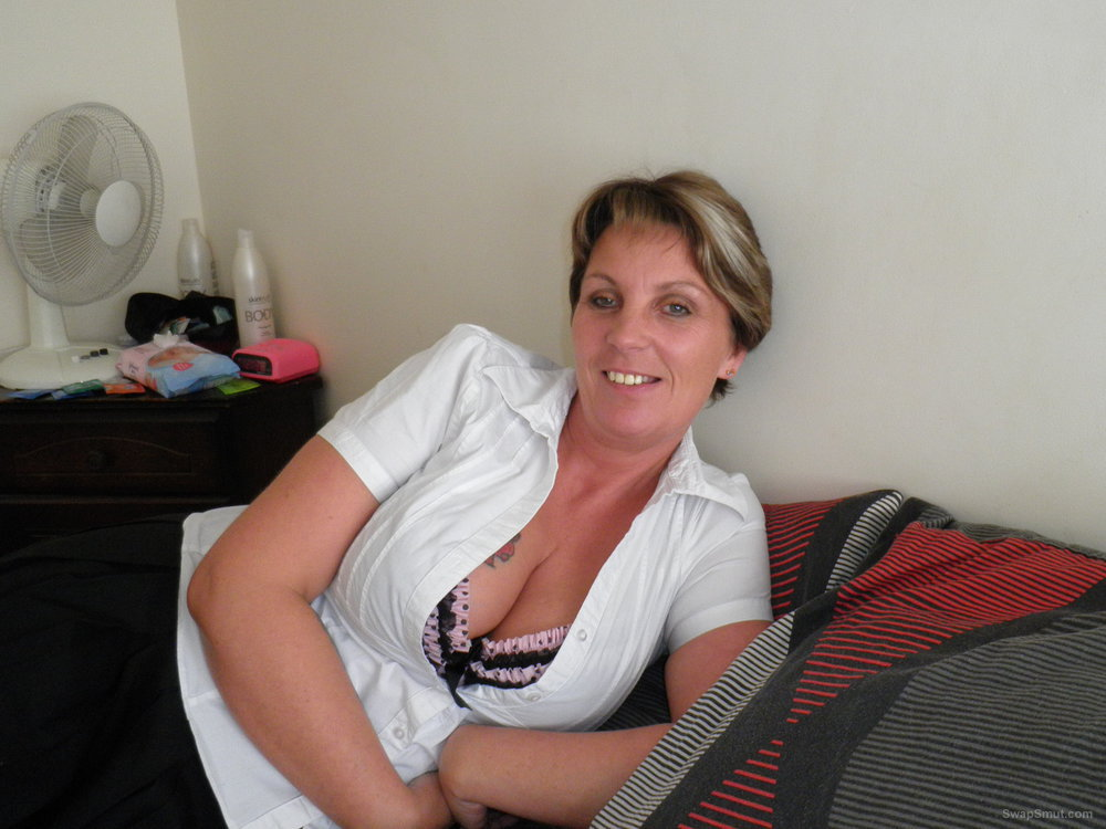 A very naughty mature MILF dressed as a French maid that loves to flash her pussy