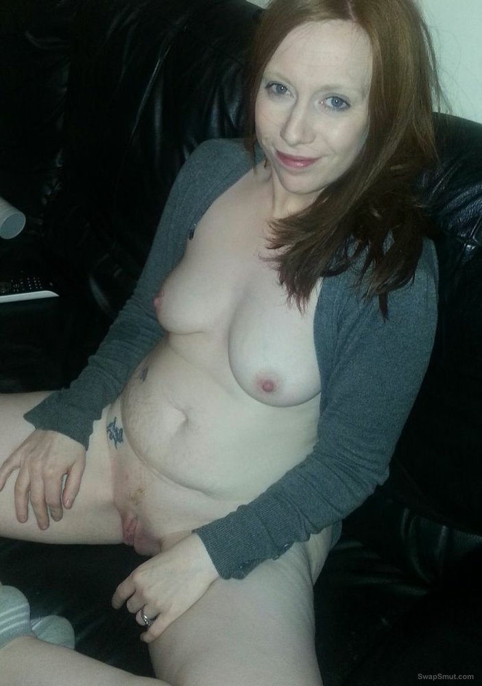 Sexy fun Dee baring some naked flesh at home on the couch
