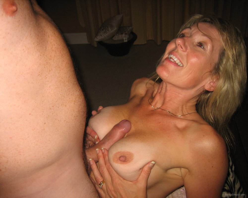 image Blonde milf having fun with a black cock