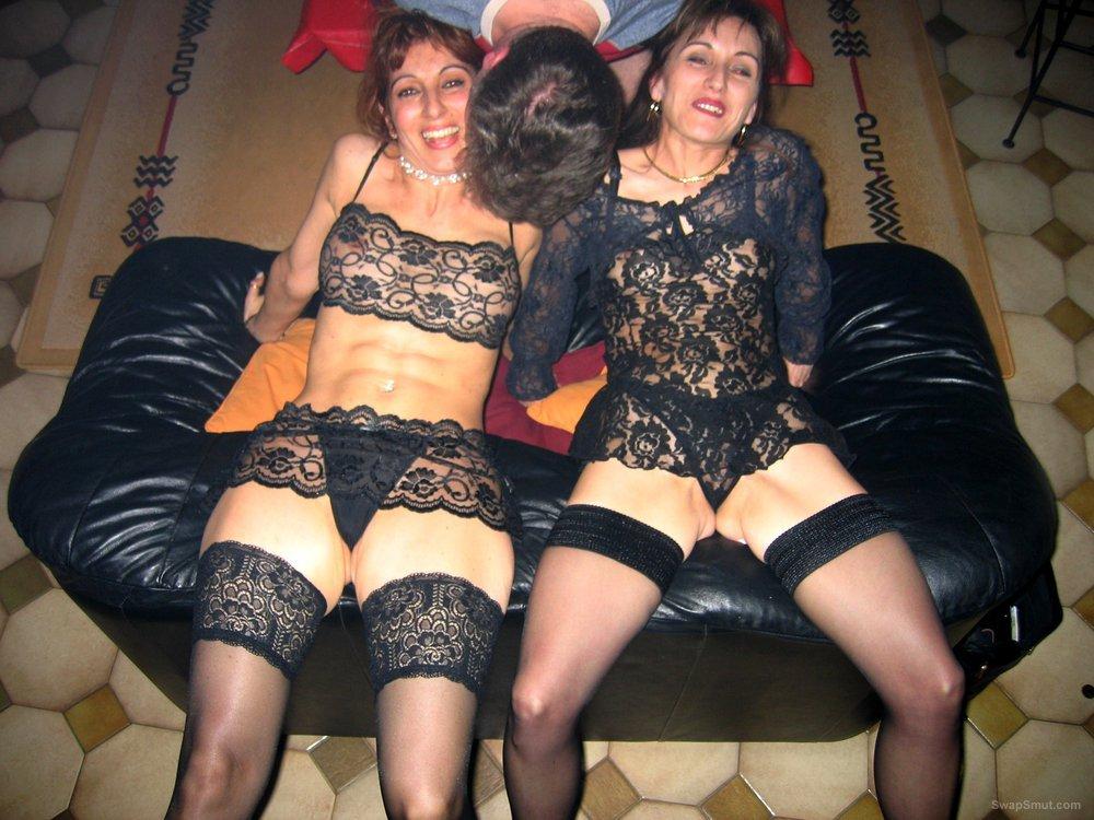 Two stunning sluts having fun at home wearing black lingerie