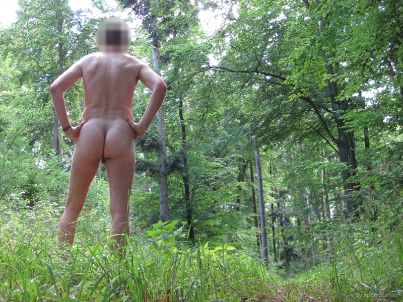 Fully nude male walking in the forest having photos taken