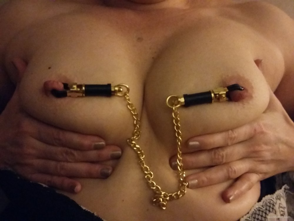 Here she is wearing some clamps and giving a little show