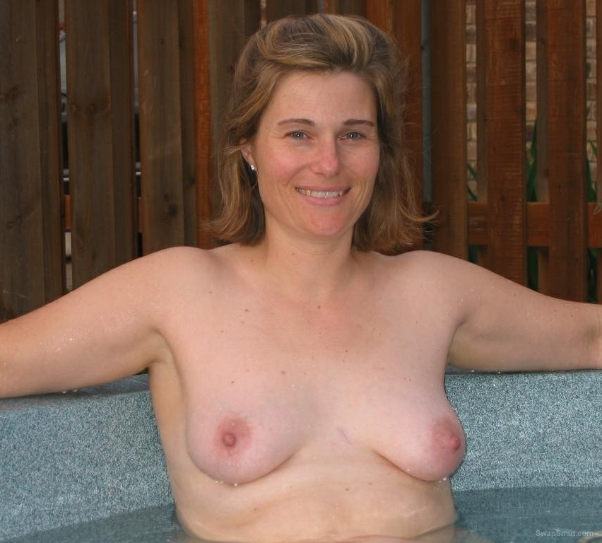 A hot milf returns to show off her hot curvy body outdoors