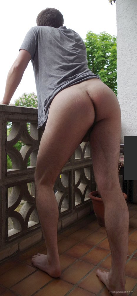 German stud - showing off on the balcony