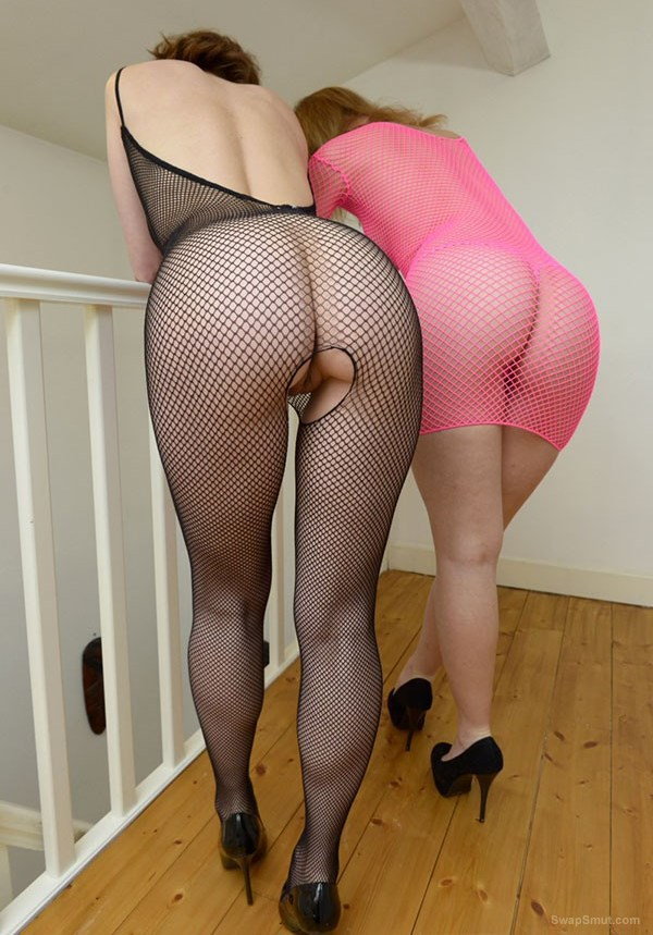 Two sexy stripper friends fooling around in fishnet body stocking