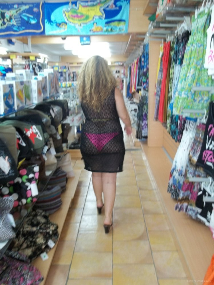 Sexy wife milf walking around in bikini with see through dress shop