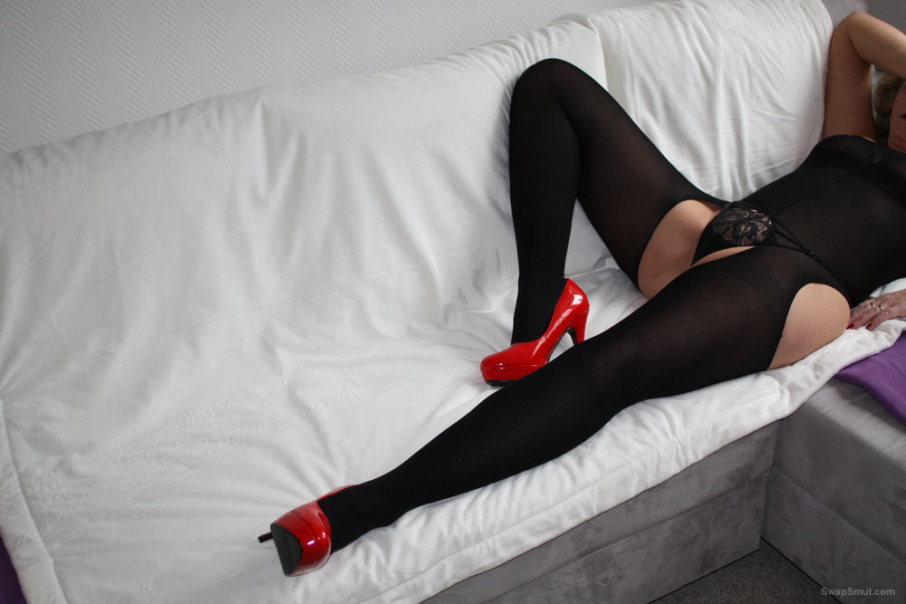 Sandrabunny legs in black stockings and feets in red high heels