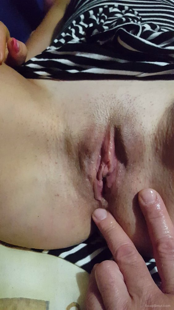 Some photos while I am masturbating her shaved and wet pussy