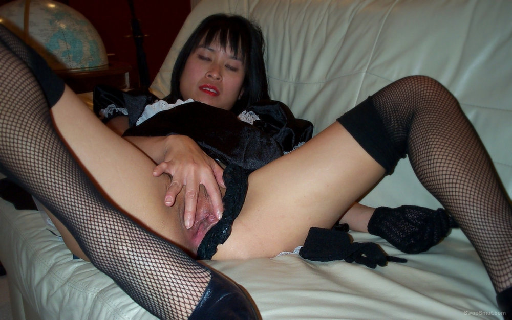 Sexy Asian maid spreads her legs for slutty photos touching vagina