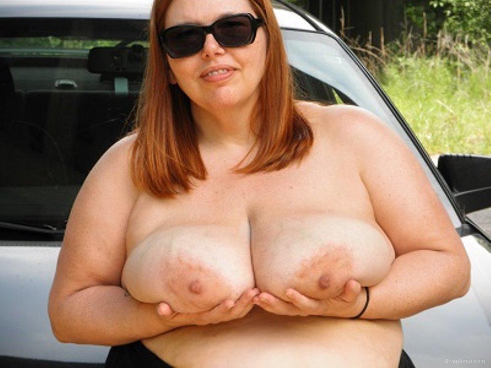 Busty slut BBW wife posing outside on a road trip