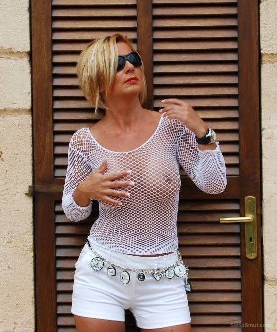 french milf showing off outside her villa