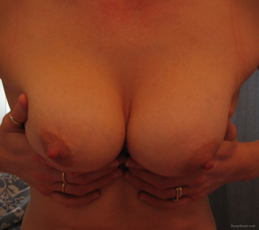 Milf showing big tits off and wanking her man