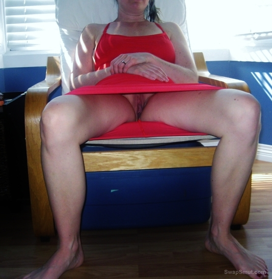 Upskirt no panty SLUT wife spreading her legs to reveal her pussy