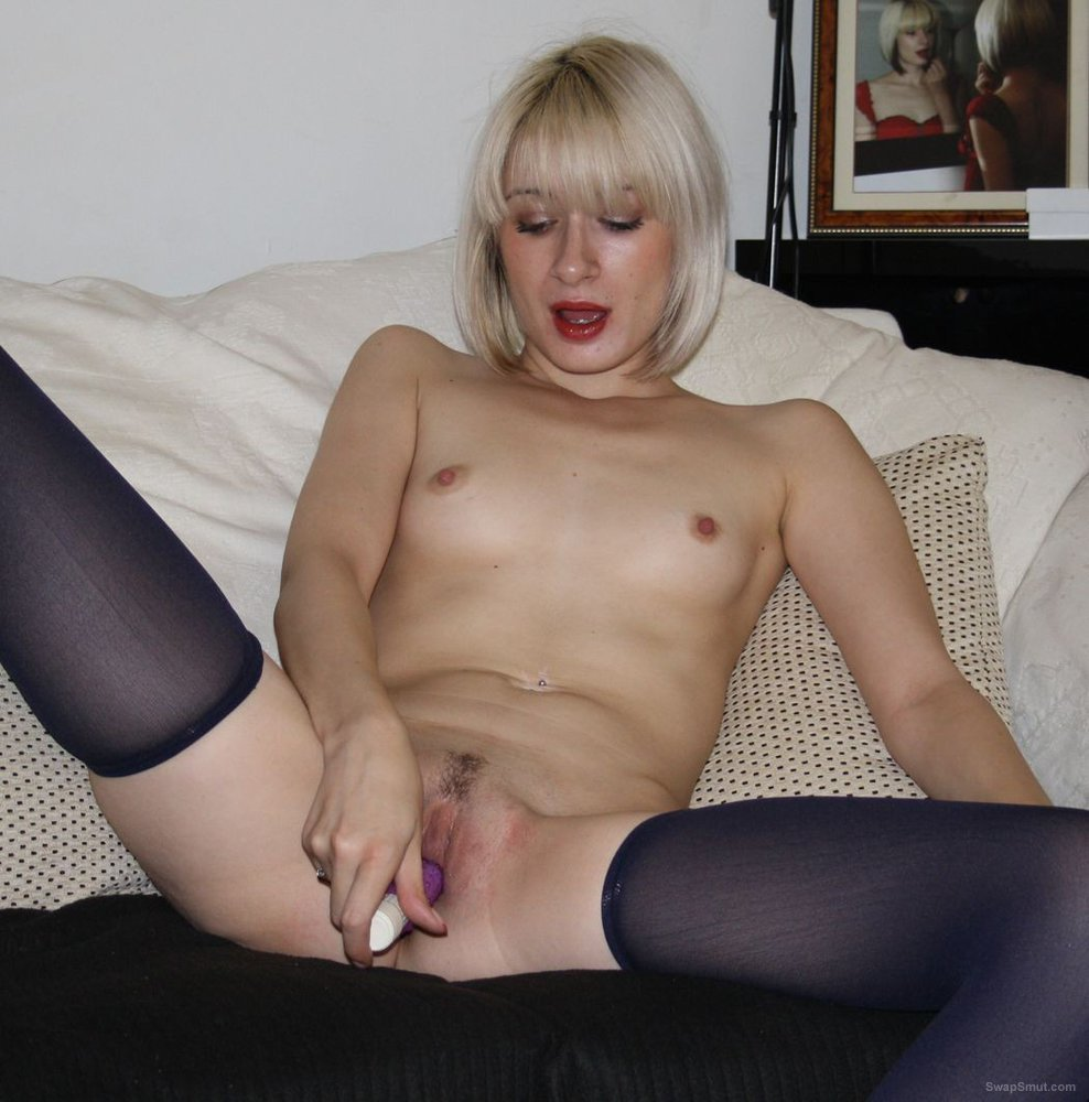Blonde swinger slut receiving jizz loads from strangers while being photographed