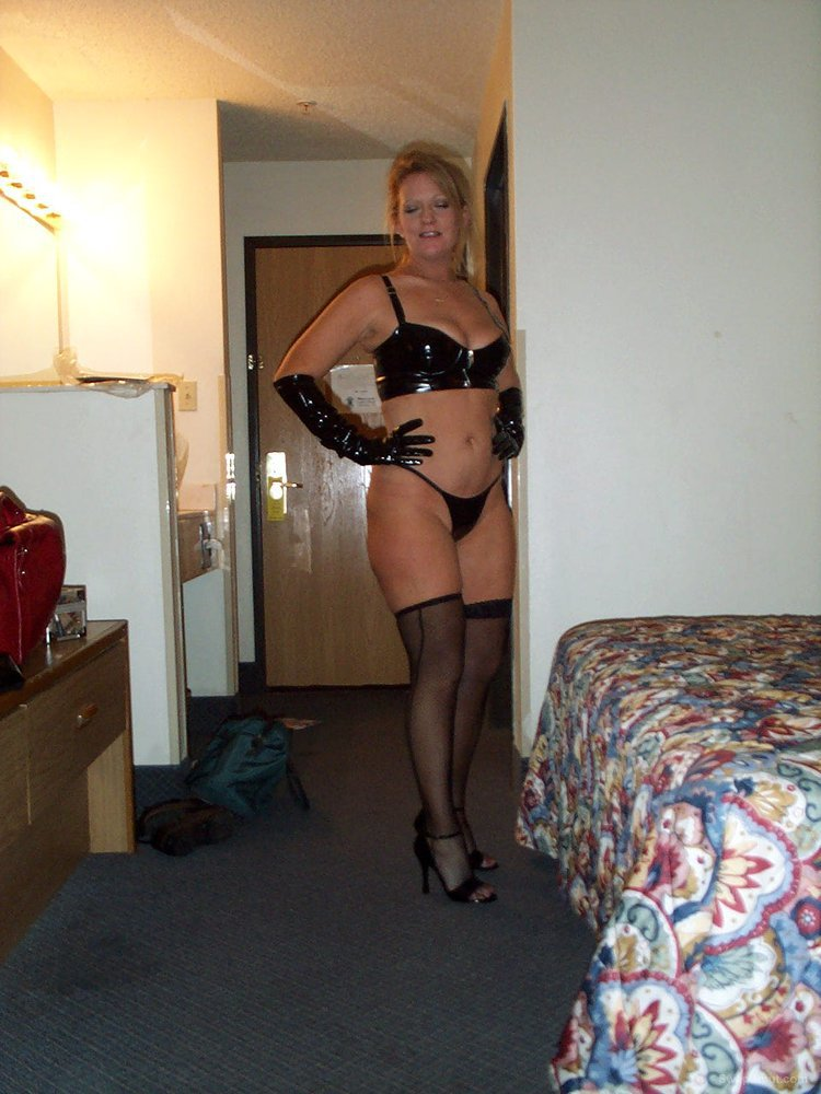 My wife in hotel room modeling some fancy lingerie amateur photos