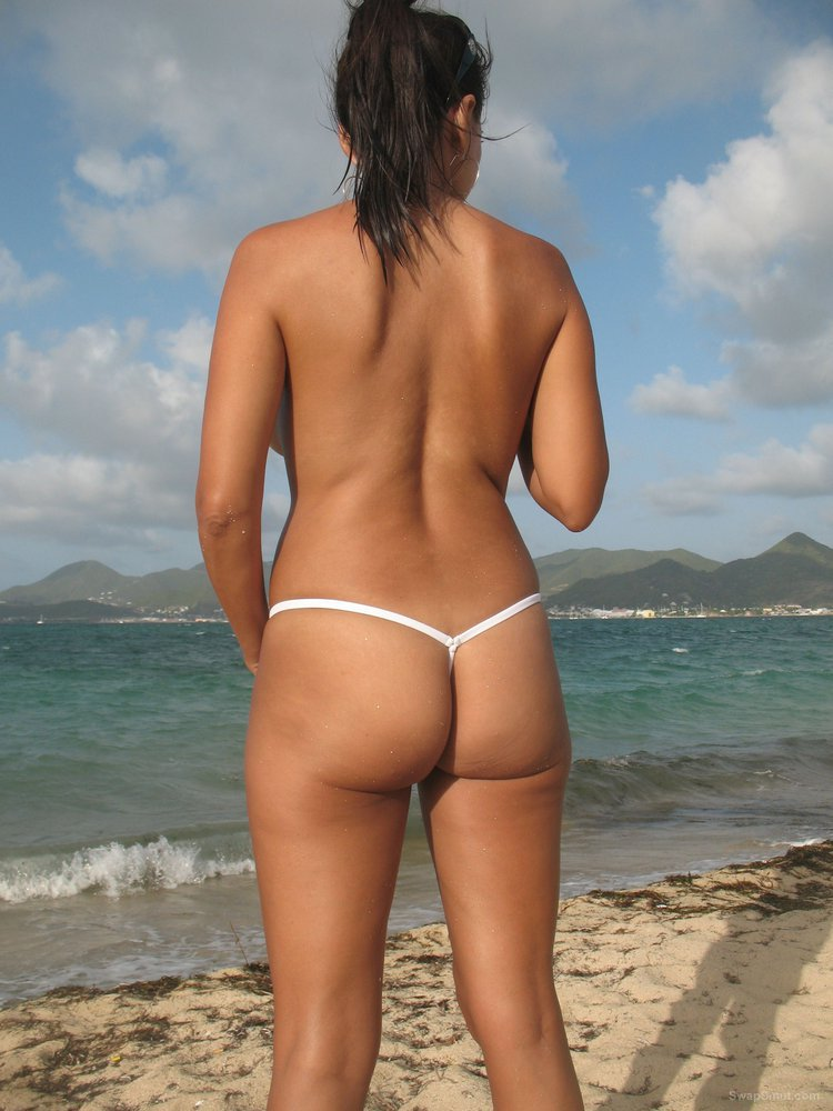 Sexy tanned mom at the beach topless nice camel toe