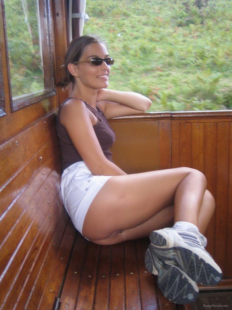Lovely brunette shows us her nice body outdoors