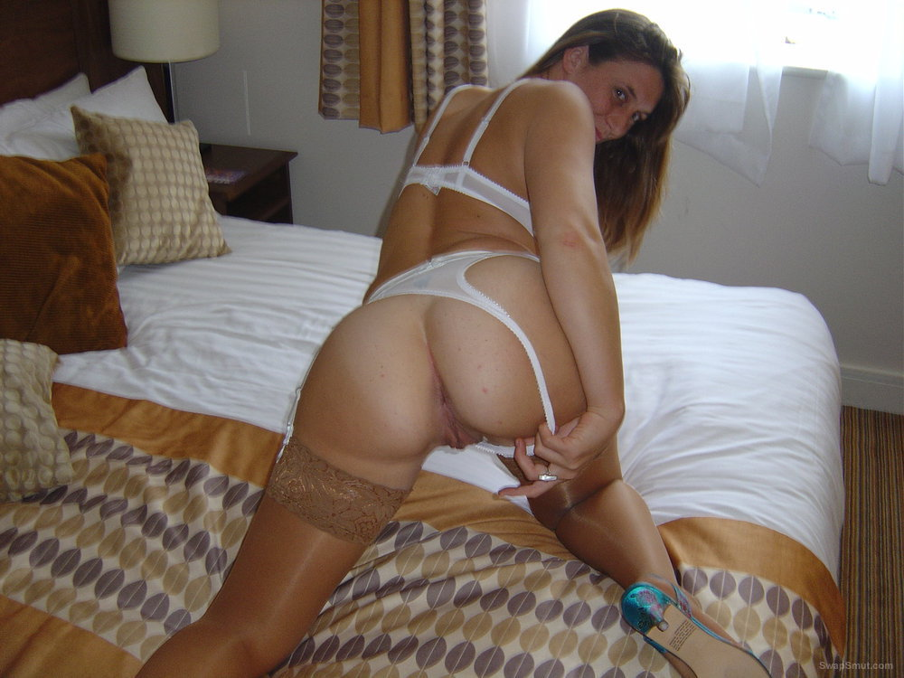 Horny brunette amateur in stockings and white thong tease