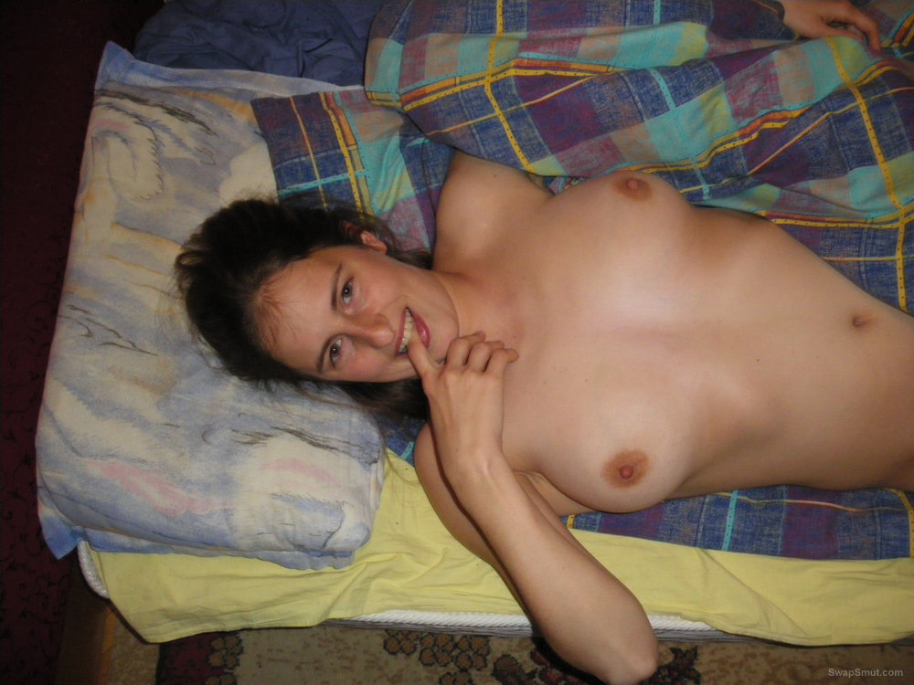Naked BUlgarian girl posing for pictures in bed