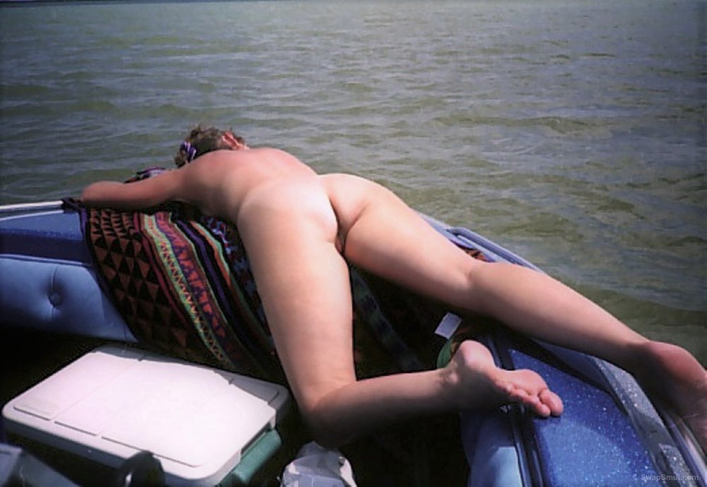 My wife's ass while boating on an area lake