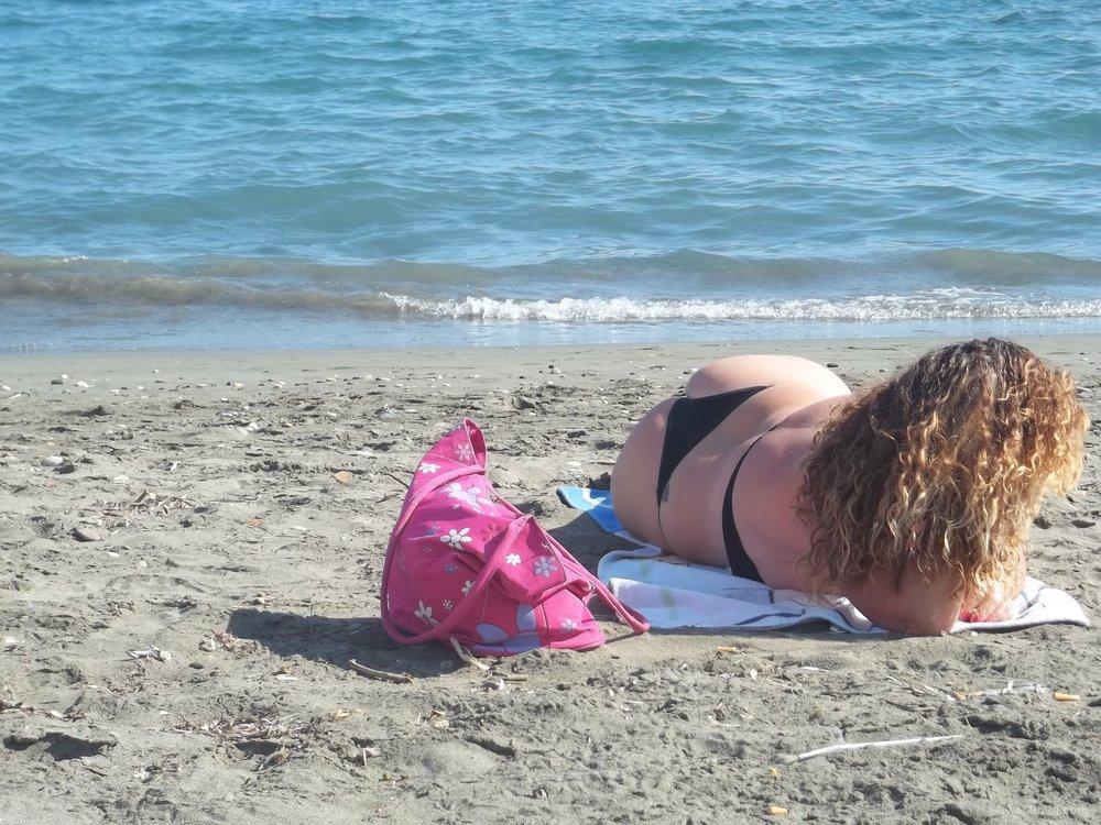 Sexy wife 32 years old milf sunbathing on a public beach