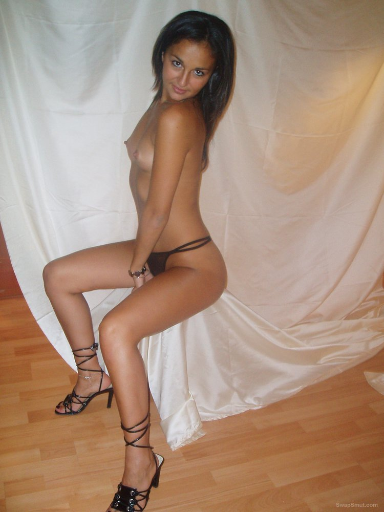 Brunette wife wearing sexy lingerie posing for photos