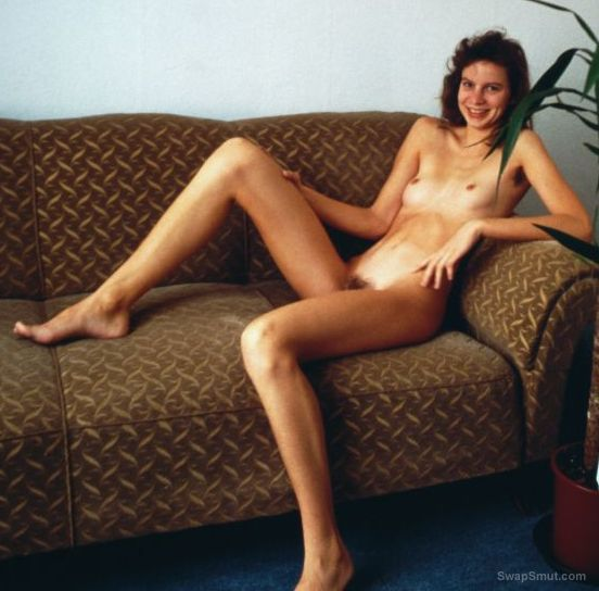 Hot german girl Bettina posing naked on the couch hairy pussy