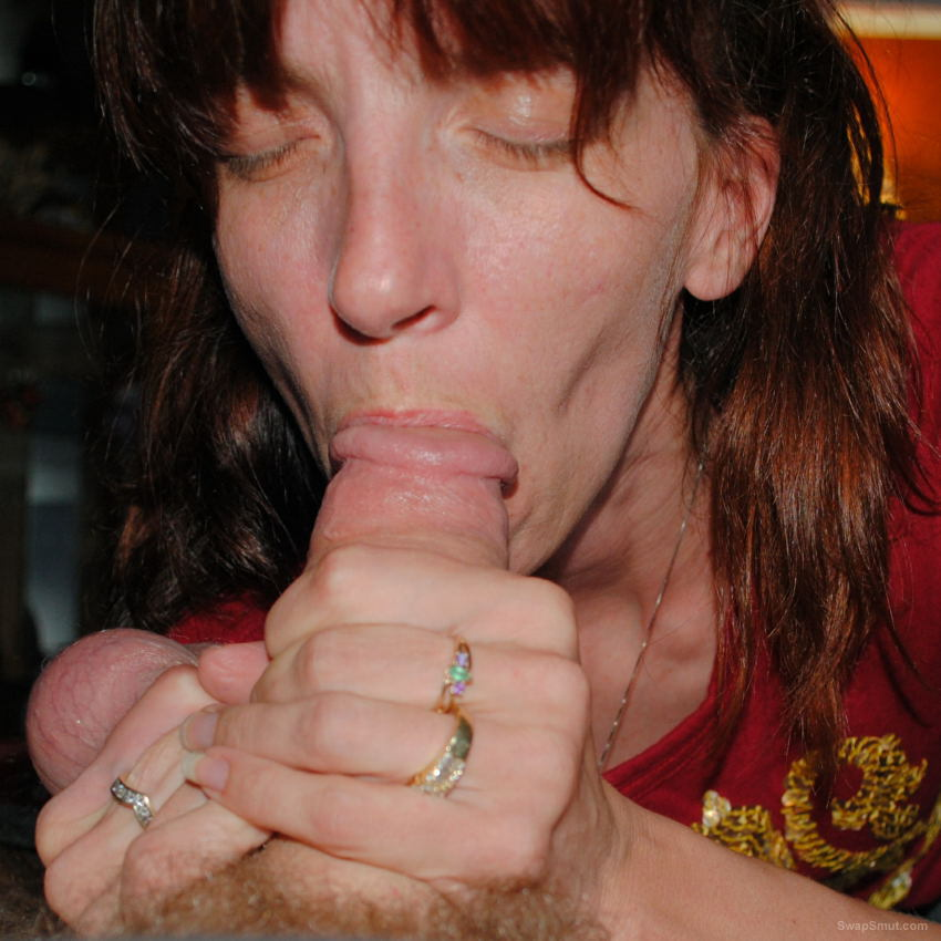 Kristi trying to pull off my cock and balls sucking hard on knob