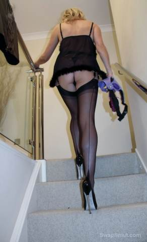 Wife in stockings pleasuring herself on a suction dildo