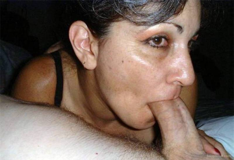 Mature bitch sucking on a cock and dildo at same time