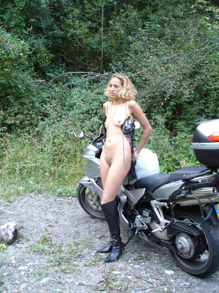 Sexy French blonde wife outdoors pics on a motor bike