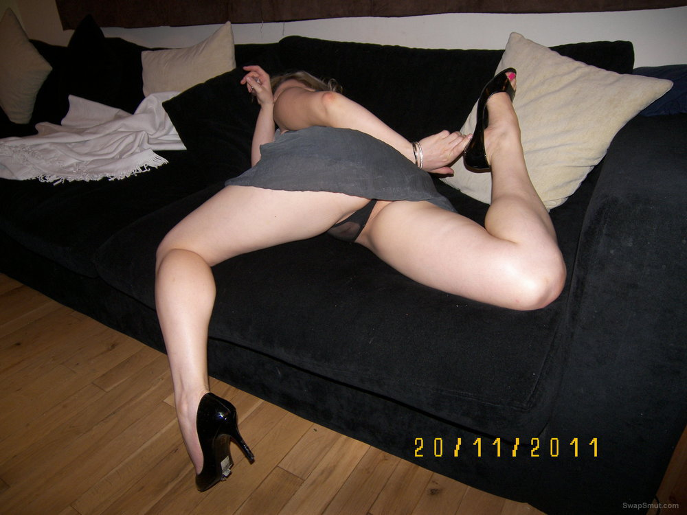 Polish lady showing some pussy on the sofa spreading her legs