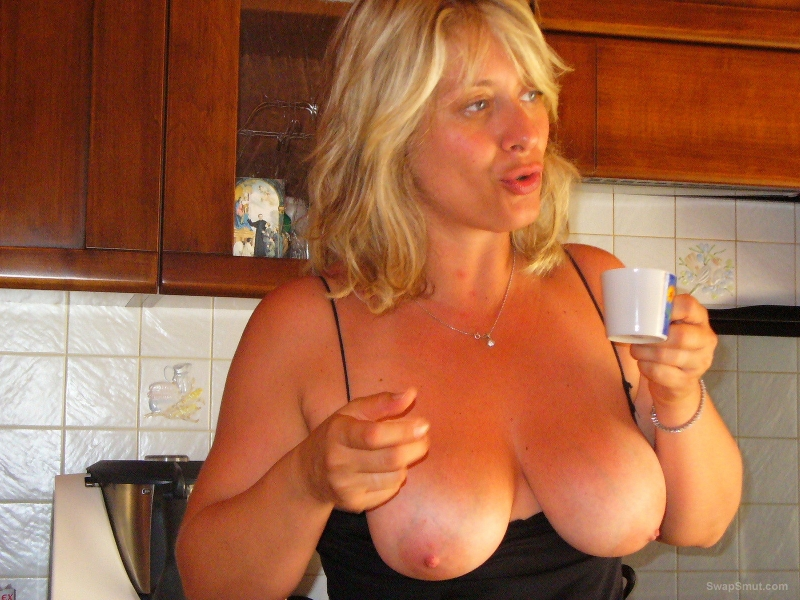 Mature blonde having fun pleasuring two men