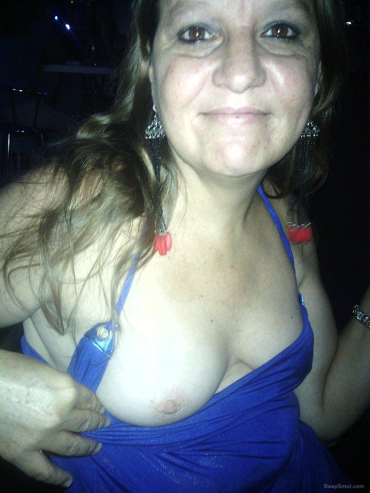 Having a little daring fun at the bar in her slutty blue dress