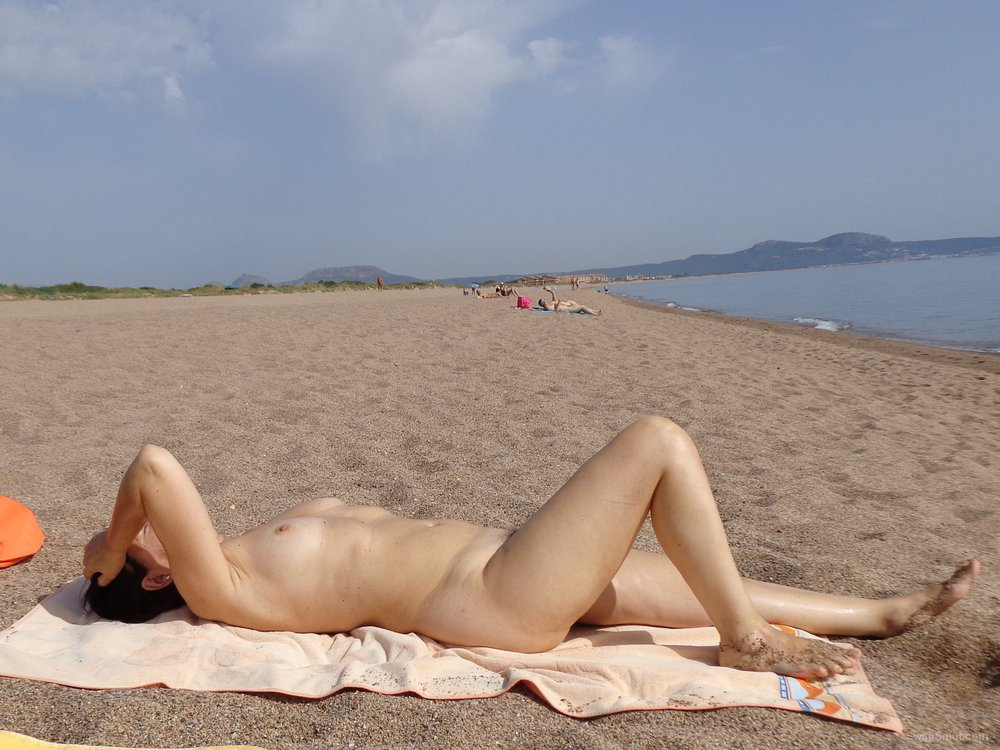 My wife salomé nude at the beach catching some sunshine
